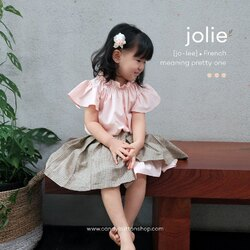 Jolie means pretty , that's why we name this pretty dress Jolie 😍 . Our Jolie Dress with Wrap Skirt is back in stock, please adopt them now before they are gone 😘 . However #momican, teach our kids that pretty doesn't mean only the appearance, the most important thing is the one which inside, yes pretty soul, indeed 😉 . #candybutton #candybuttonshop #jolie #babyshopbandung #handmadeaccessory #hairaccessories #kidsfashion